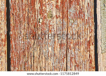 Old wooden background of vertical boards with peeling red color #1175812849