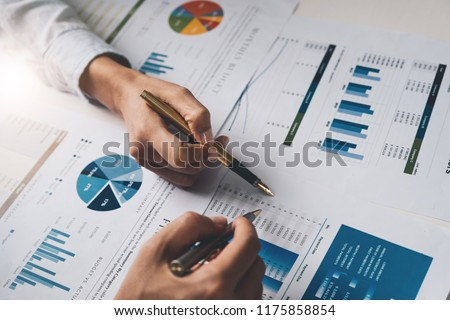 Close up Business people meeting to discuss the situation on the market. Business Financial Concept #1175858854