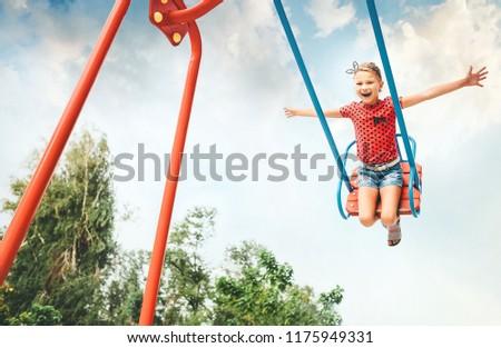 Little girl swing on swing #1175949331