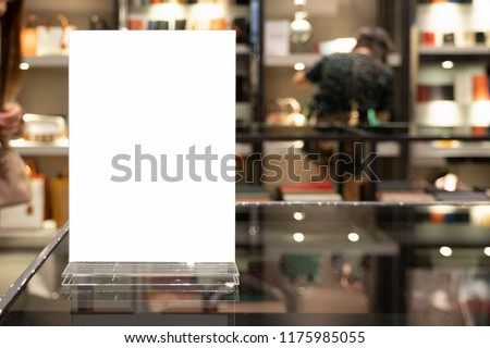 Mock up Menu frame in shopping mall,Stand for booklets with white sheets of paper acrylic tent card on table on.