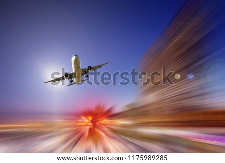 Airplane flying with dynamic colorful motion blur abstract background #1175989285