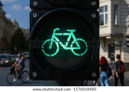 Bicycle traffic signal, green light, road bike, free bike zone or area, bike sharing #1176018400