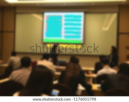 Blurred background of meeting room with participants and presentations of slides shows. #1176055798