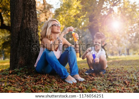 they have a great family time in the park #1176056251