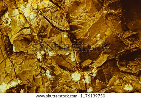 Gold texture. Rough structure mineral. Rock texture. Gold Ore. Gold rocks. Stone background.  #1176139750