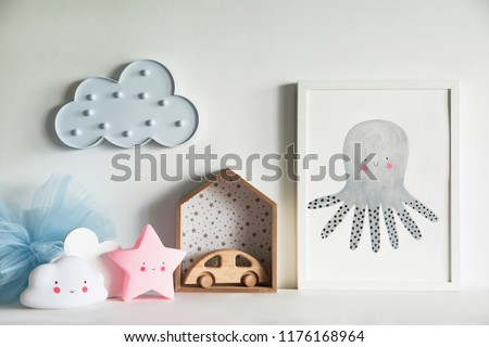 The modern scandinavian newborn baby room with mock up poster frame, wooden car, stars, toys and clouds. Minimalistic and cozy interior with white walls. #1176168964