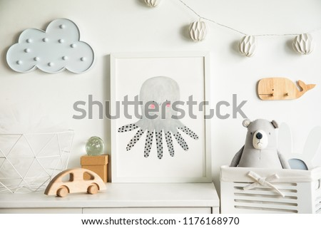 Scandinavian newbornbaby shelf with mock up photo frame, wooden accessories, toys, teddy bear and hanging cloud. White and cozy childroom.  #1176168970