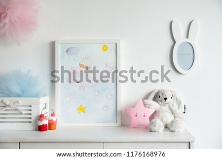 Stylish scandinavian nursery interior with mock up photo frame , mirror, pinky star and toys. The white background wall.