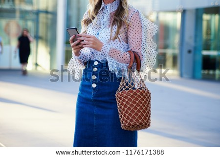 Woman Wearing Denim Skirt and Netted Bag, Casual Wear, Midsection #1176171388