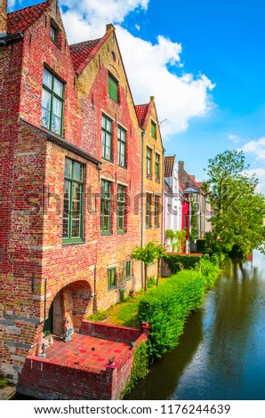 Beautiful canal and traditional houses in the old town of Bruges (Brugge), Belgium #1176244639