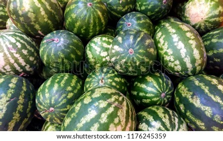 watermelons background at the market  #1176245359