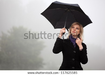 Young woman against a morning foggy landscape #117625585