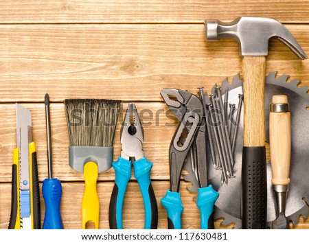 Different tools on a wooden planks with space for text #117630481