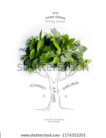Environmentally friendly concept.Symbolic tree, made of green leaves and branches with hand drawn cartoon sketch a trunk with branches. Save environment rescue the forests.  Ecology Concept.Flat lay. #1176352201