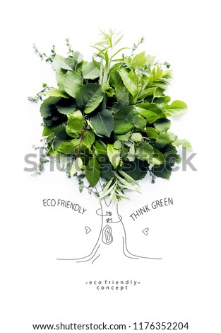 Environmentally friendly concept.Symbolic tree, made of green leaves and branches with hand drawn cartoon sketch a trunk with branches. Save environment rescue the forests.  Ecology Concept.Flat lay. #1176352204