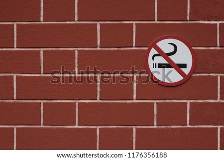 The sign does not smoke on the wall.
