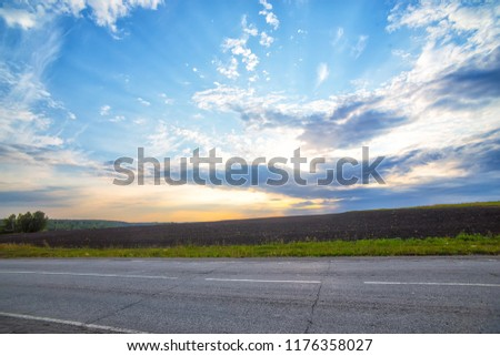 highway and cloudy sky at sunset in the background #1176358027