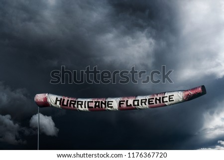 Photo manipulated image of a extra long windsock showing the power of Hurricane Florence.