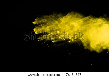 Abstract of yellow powder explosion on black background. Yellow powder splatted isolate. Colored cloud. Colored dust explode. Paint Holi. #1176434347
