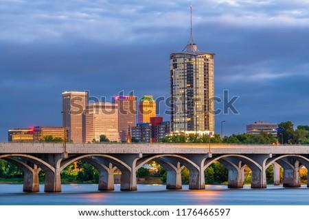 Tulsa, Oklahoma, USA downtown skyline on the Arkansas River at dusk.