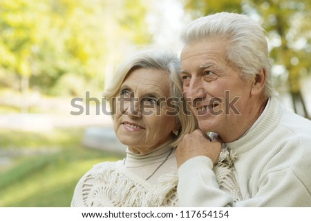 nice old couple standing in autumn park #117654154