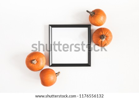 Autumn composition. Photo frame, pumpkins on white background. Autumn, fall, halloween concept. Flat lay, top view, copy space, square