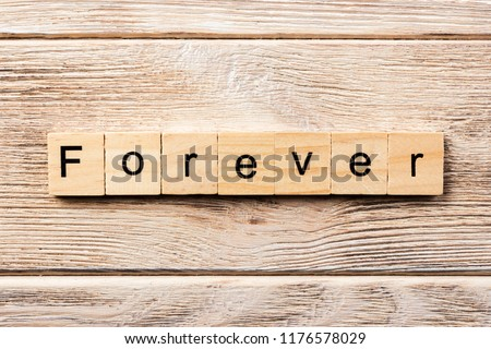 forever word written on wood block. forever text on table, concept.