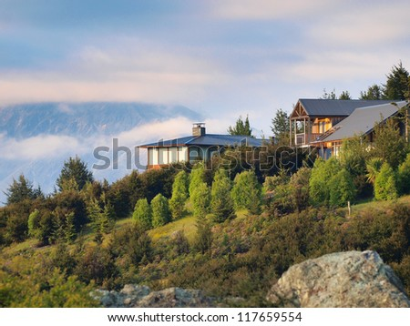 Houses in the hills on the New Zealand countryside #117659554
