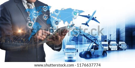 Abstract image of business man point to the hologram on smartphone and Industrial Container Cargo freight ship, forklift handling container box loading for logistics financial and internet of things #1176637774