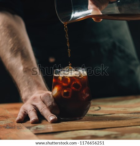 Pouring cold brew coffee #1176656251