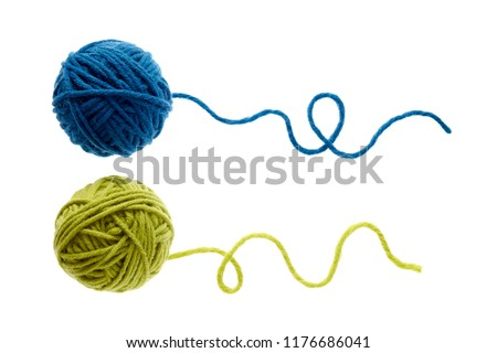 Blue and green woolen balls over white background. Two balls of wool partially unrolled.  #1176686041