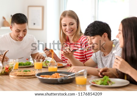 Friends eating at table in kitchen #1176854209