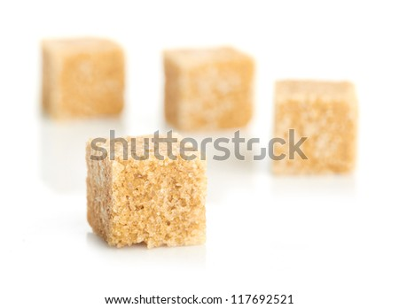 Brown cane sugar cubes #117692521
