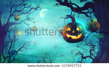 Halloween  with Pumpkins and Dark Forest. Scary Halloween Design on table