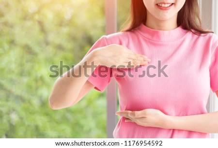 Close up Happy woman with a pink ribbon  for  Prevention Breast cancer or  Breast Cancer Awareness Concept. #1176954592