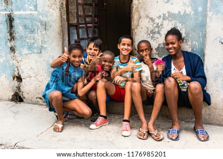 Havana / Cuba - March 22, 2016: Cuban children living in poverty smiling and posing for photos. #1176985201