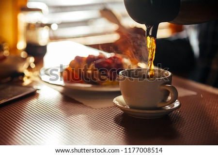 Waitress Pouring Fresh Coffee At A Classic Breakfast Diner #1177008514