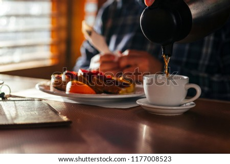 Waitress Pouring Fresh Coffee At A Classic Breakfast Diner #1177008523