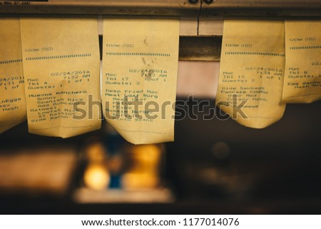 Order Tickets Hanging In The Kitchen Of A Vintage Diner #1177014076