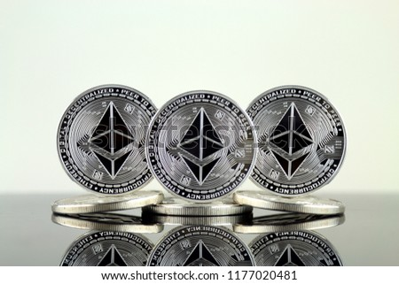 Physical version of Ethereum (ETH). Conceptual image for investors in cryptocurrency, Blockchain Technology, Smart Contracts, Personal Tokens and Initial Coin Offering. #1177020481