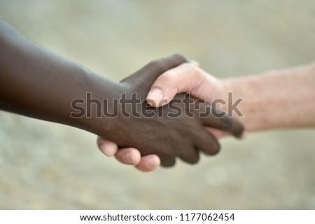 Multi-Ethnic Close up portrait of hands in handshake #1177062454