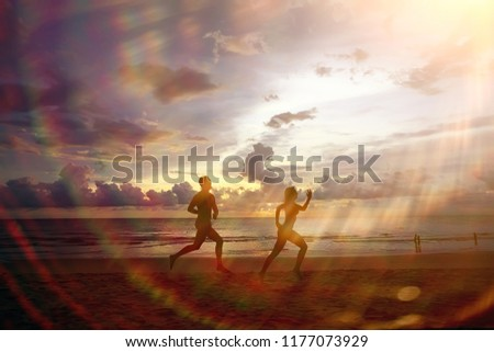 silhouettes of athletes running along the beach / sports summer in the warm sea, healthy rest, sports activity, summer vacation #1177073929
