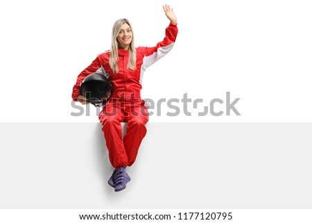 Female racer sitting on a panel and waving isolated on white background #1177120795