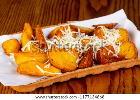 Fried potato slices with cheese #1177134868
