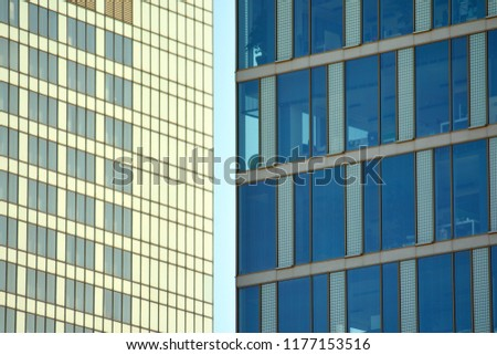 Abstract fragment of contemporary architecture, walls made of glass and concrete. Glass curtain wall of modern office building #1177153516