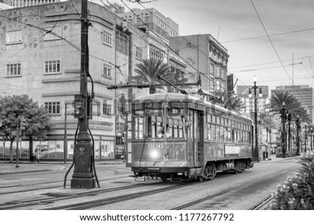 Streetcar in downtown New Orleans, USA at twilight Royalty-Free Stock Photo #1177267792