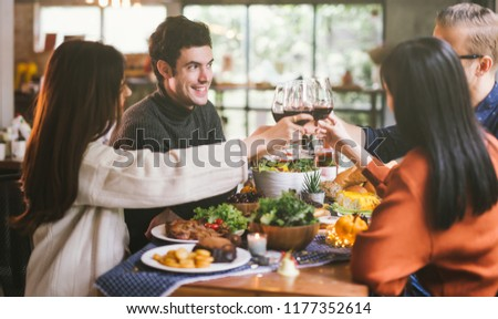 Dinner with friends. Group of young people enjoying dinner together. Dining Wine Cheers Party Concept #1177352614