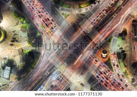 High angle view of road intersection at downtown of Seoul in South Korea in evening. Cars and colorful buses on streets. Night city traffic. Seoul is a popular tourist destination of Asia. #1177371130