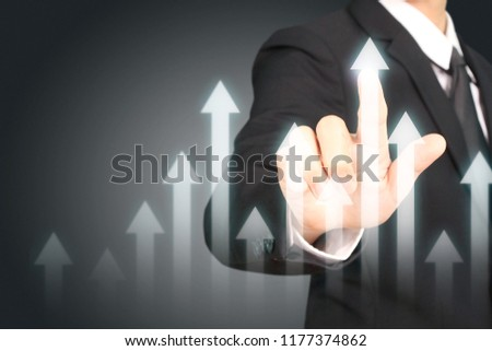 Businessman plan graph growth and increase of chart positive indicators in his business #1177374862
