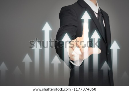 Businessman plan graph growth and increase of chart positive indicators in his business #1177374868